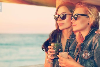 Two women drink healthy alcohol